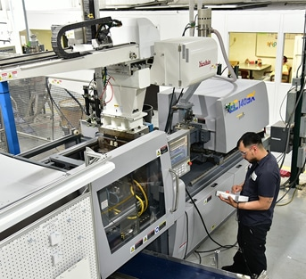 Photo of production molding machinery